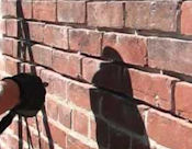 Re-pointing a brick wall